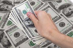 Dólares del americano del efectivo Foto de archivo libre de regalías