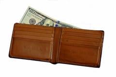 Dólares del banco en la cartera Brown Imagen de archivo libre de regalías