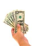 Dólares del dinero de la explotación agrícola de la mano aislados Imágenes de archivo libres de regalías
