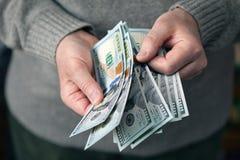 Dólares del recuento de la mano Fotos de archivo