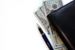 Dólares, diario y pluma Imagenes de archivo