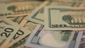 Dólares do dinheiro video estoque