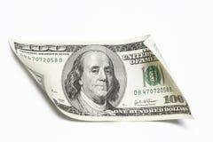 Dólares do dinheiro em um fundo branco Imagens de Stock Royalty Free