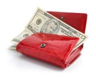Dólares do dinheiro na bolsa vermelha isolada fotos de stock royalty free