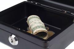 Dólares doblados en escritorio de efectivo Imagen de archivo