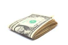 Dólares dobrados imagem de stock