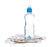 Dólares e água Imagem de Stock