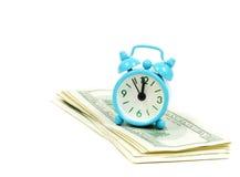 Dólares e alarme foto de stock
