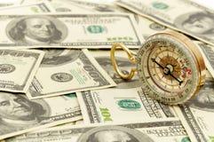 Dólares e compasso. imagens de stock royalty free