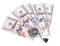 Dólares e compasso fotografia de stock royalty free