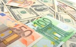 Dólares e euro Foto de Stock Royalty Free