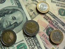 Dólares e euro Fotografia de Stock