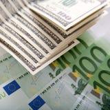 Dólares e euro Fotos de Stock