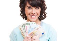 Dólares e euro da terra arrendada da mulher Fotos de Stock