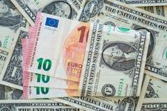 Dólares e euro- dinheiro Fotografia de Stock Royalty Free