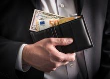 Dólares e euro na carteira Imagem de Stock Royalty Free