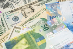 Dólares e francos suíços Fotos de Stock
