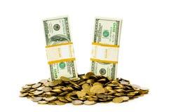 Dólares e moedas isolados Foto de Stock Royalty Free