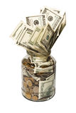 Dólares e moedas no vidro. Fotos de Stock Royalty Free