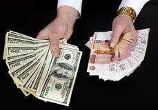 Dólares e rublos Fotografia de Stock