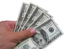 Dólares em uma mão Imagem de Stock Royalty Free