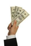 Dólares em uma mão do homem de negócios Foto de Stock