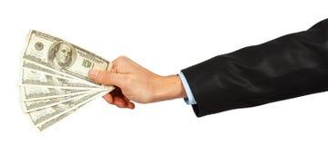 Dólares em uma mão do homem de negócios Fotos de Stock