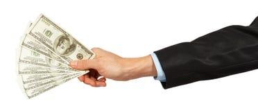 Dólares em uma mão do homem de negócios Imagem de Stock Royalty Free