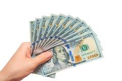 Dólares em uma mão em um fundo branco Fotografia de Stock Royalty Free