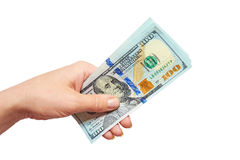 Dólares em uma mão em um fundo branco Foto de Stock Royalty Free