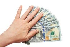 Dólares em uma mão em um fundo branco Fotos de Stock