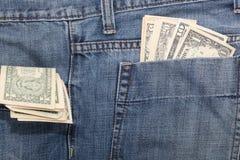 Dólares en bolsillos Imagen de archivo