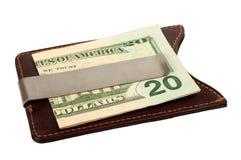 Dólares en clip del dinero. Fotos de archivo