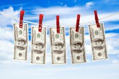 Dólares en cuerda. Fotografía de archivo libre de regalías