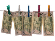 Dólares en cuerda para tender la ropa Imagen de archivo