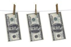 Dólares en el clothespin Imagen de archivo libre de regalías