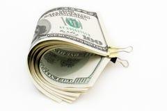 100 dólares en el fondo blanco Imagen de archivo