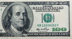 Dólares en el fondo blanco Fotos de archivo