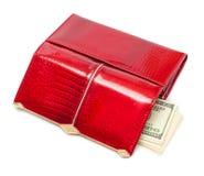 Dólares en el monedero rojo Fotografía de archivo libre de regalías