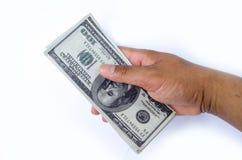 Dólares en la mano Fotografía de archivo libre de regalías