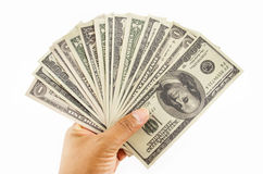Dólares en la mano Imagen de archivo libre de regalías