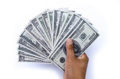 Dólares en la mano Fotos de archivo