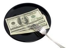 Dólares en la placa negra Fotografía de archivo libre de regalías