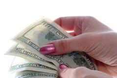 Dólares en manos Imágenes de archivo libres de regalías