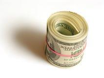 Dólares en rodillo Fotos de archivo libres de regalías