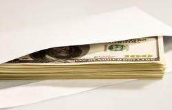 Dólares en sobre Fotos de archivo libres de regalías