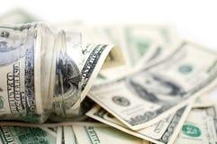 Dólares en tarro del dinero Fotos de archivo