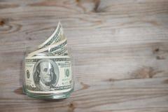 Dólares en tarro del dinero Foto de archivo libre de regalías