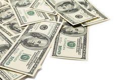 Dólares en un fondo blanco Foto de archivo