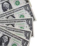 Dólares en un fondo blanco, primer Fotos de archivo libres de regalías